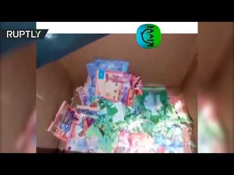 شاهد فأران يتلفان ثروة نقدية داخل صراف آلي في أستانا