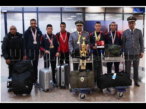 شاهد استقبال عدائي نادي الجيش الملكي لألعاب القوى في المطار