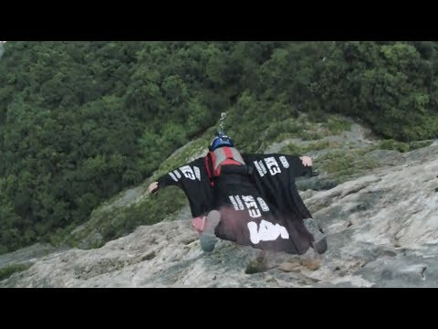 chinese wingsuit pilot becomes the first in the world