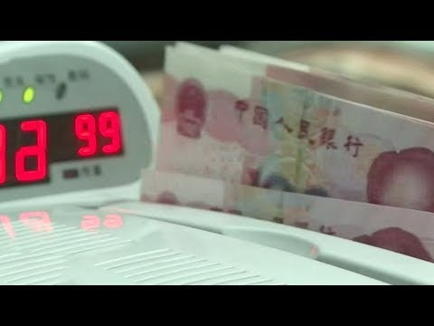 new yuan loans hit oneyear low