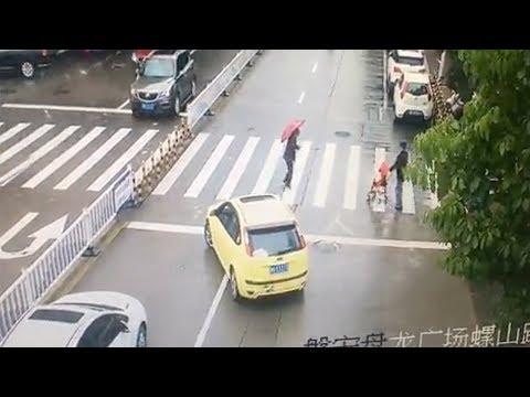 car blocks traffic to allow old woman