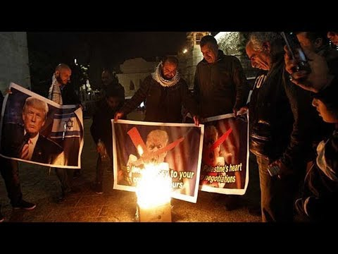 palestinian protesters burn posters of trump after move