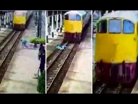 المغرب اليوم  - قطار يقطع شاب تايلاندى لكنه يقوم ويجرى بمعجزة