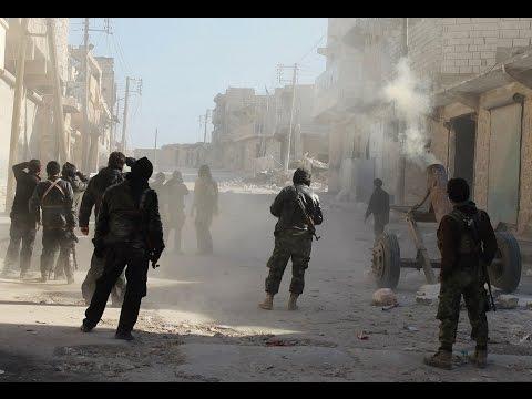 المغرب اليوم  - بالفيديو داعش يهاجم مدينة دير الزور لربط العراق بسورية