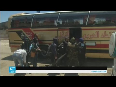 المغرب اليوم  - بالفيديو مسلحو حي الوعر في حمص يغادرونه إلى إدلب وجرابلس