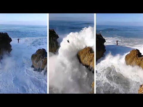 شاهد موجة عملاقة تصيب متهور يسير أعلى حبل