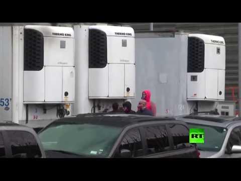 شاهد شاحنات مبردة للجثث تنتشر في شوارع نيويورك الأميركية