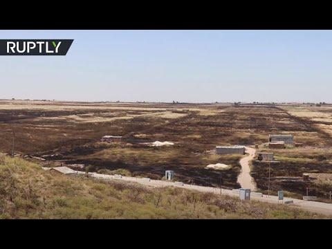 شاهد الحرائق تلتهم المئات من حقول القمح في سورية ومقتل شخصين