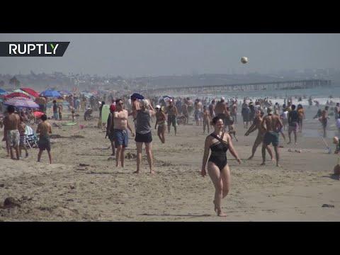 شاهد الشواطئ مكتظة أثناء موجة الحر في كاليفورنيا رغم حظر كورونا