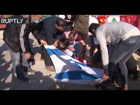 متظاهرون يحرقون العلمين الأميركي والإسرائيلي جنوبي لبنان